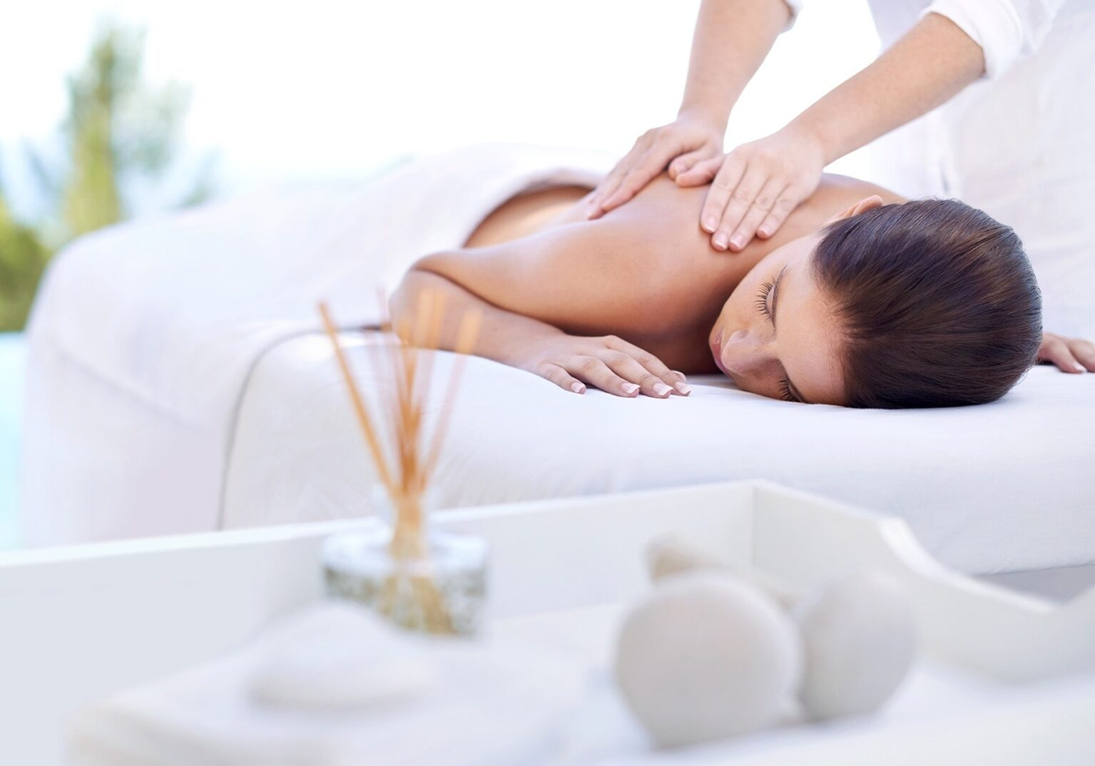 Cropped shot of an attractive young woman enjoying a relaxing massage